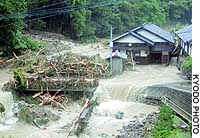 A house in Onohara, Kagawa Prefecture, is flooded after Typhoon Megi swamped western Japan with heavy rain.