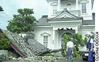 Tsuruoka, Yamagata Pref. - locals clean up the entrance to the Chido Museum here Friday after the gate collapsed due to the strong winds of Typhoon Megi.