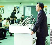 Katsuya Okada announces his plans to seek re-election as chief of the Democratic Party of Japan at DPJ headquarters.