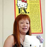 Yuko Yamaguchi, the current designer of popular feline character Hello Kitty, holds a stuffed version of the cat at Sanrio Co. in Shinagawa Ward, Tokyo.