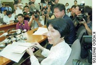 Hideko Hakamada, sister of Iwao Hakamada, who has been on death row for 36 years, speaks Friday in Tokyo after the Tokyo High Court rejected the man's retrial plea.
