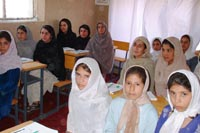 Afghan women study at a 'terakoya' community learning center in the village of Istalif. | PHOTO COURTESY OF THE NATIONAL FEDERATION OF UNESCO ASSOCIATIONS IN JAPAN