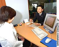 A temporary worker in her 30s speaks with a job coordinator at the With Co. employment agency in Shibuya Ward, Tokyo.