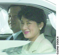Crown princess Masako smiles from her limousine Saturday afternoon as she and Crown Prince Naruhito visit the Imperial Palace.