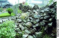 A pile of rocks is all that remains of a section of the stone wall at Seikanin Temple in Shingu, Wakayama Prefecture, in the wake of two powerful earthquakes that struck western Japan.