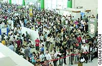 The departure lobby of Naha airport in Okinawa Prefecture is packed with passengers stranded by Typhoon Songda.
