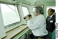 Prime Minister Junichiro Koizumi views the disputed Russian-held Habomai islets from a Japan Coast Guard boat last week.