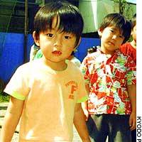 Hayato Kobayashi (left) and his brother, Kazuto, are seen in this picture taken Saturday, the day they disappeared. Below, Akihiro Shimoyama.