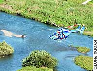 A police helicopter searches the Omoi River in Oyama, Tochigi Prefecture, for the missing brother of a boy found dead along the river earlier in the day.