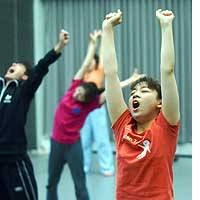 Actors warm up during the New National Theater's training program in Shibuya Ward, Tokyo, in August.