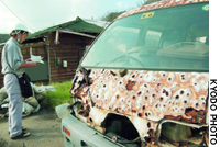 A van in the Miike district of Miyake Island is testament to the destruction wrought by years of exposure to volcanic gas and other elements.