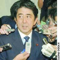 Shinzo Abe, Liberal Democratic Party secretary general, speaks to reporters after emerging from a meeting with Prime Minister Junichiro Koizumi on Friday afternoon.