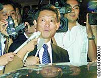 North Korean diplomat Song Il Ho is mobbed by reporters after emerging from working-level talks with Japan in Beijing.