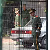 Chinese paramilitary officers stand outside the North Korean Embassy in Beijing as Japanese and North Korean diplomats hold a second day of talks.