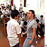 Canadian Bill Pozzobon provokes a student in a role-play at Hakusan High School in Midori Ward here in September during a SafeTeen iolence-prevention workshop for boys.