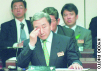 Kochi Gov. Daijiro Hashimoto pauses during Friday's session of the prefectural assembly before it passed a resolution urging him to step down.