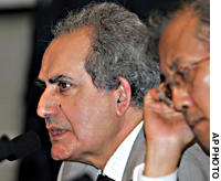 Iraq's planning minister, Madhi al-Hafidh (left), answers a question during a joint news conference held after Iraq reconstruction donor nations wrapped up a two-day conference in Tokyo on Thursday.