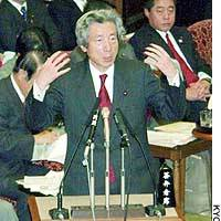 Prime Minister Junichiro Koizumi answers questions during a House of Councilors Budget Committee session Wednesday.