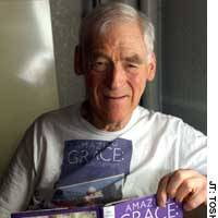 Ray Smith displays his book, which recounts his experiences in caring for his late wife, during a recent interview at a Tokyo hotel.
