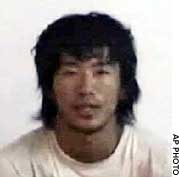 A screen shot from a video posted on a militant Islamic Web site shows a Japanese hostage identified as Shosei Koda.