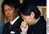 Setsuko Koda, whose son Shosei is being held hostage in Iraq, cries during a news conference Friday morning at the Foreign Correspondents' Club in Tokyo.