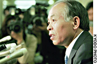 Released on bail, former Lower House member Muneo Suzuki speaks to reporters Friday after the Tokyo District Court gave him a two-year prison term for bribery.