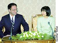 Princess Nori and Yoshiki Kuroda, a Tokyo Metropolitan Government employee, field questions Thursday at the Imperial Household Agency after formally announcing their plan to get engaged.