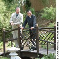 Nigel Chalk, the gardens and countryside manager at Kingston Lacy, and Counselor Futao Motai, director of the Japan Information and Cultural Centre at the Japanese Embassy in London, chat in the Edwardian Japanese garden, which recently reopened in Britain.