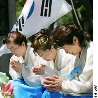 South Korean residents in Japan pray at a cenotaph here dedicated to Korean victims of the Aug. 6, 1945, atomic bombing.