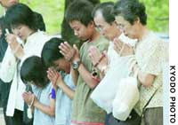 Three generations of the same family pray Saturday morning at Hiroshima's Peace Memorial Park for the souls of their relatives killed in the Aug. 6, 1945, atomic bombing.
