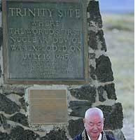 Daijo Ota, head priest at Kotaiji Temple in Nagasaki, prays Tuesday over a flame preserved from the fires caused by the 1945 atomic bombing of Hiroshima during a ceremony at the Trinity Site obelisk in Alamogordo, N.M.