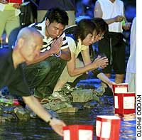 Relatives of victims in the August 1985 Japan Airlines jumbo jet crash float paper lanterns down a river near the crash site Thursday night in Gunma Prefecture.