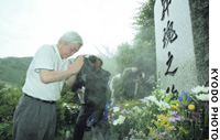 Japan airlines President Toshiyuki Shinmachi pays his respects Friday at a monument in Ueno, Gunma Prefecture, dedicated to the victims of the Aug. 12, 1985, Japan Airlines jumbo jet crash.