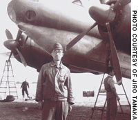Jiro Tanaka, an aircraft engineer during the war, poses in front of a Ki-74 bomber at an airfield in Kofu, Yamanashi Prefecture, immediately after Japan surrendered in August 1945.