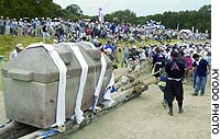 People pull a wooden sled carrying a 7-ton stone burial chamber in Takatsuki, Osaka Prefecture, on Sunday.