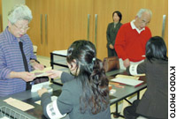 Voters receive ballots Wednesday at the Japanese Consulate General here, where an election office was opened for the Sept. 11 House of Representatives poll.