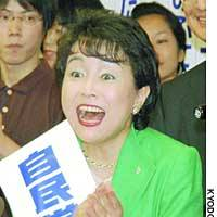 Kuniko Inoguchi of the Liberal Democratic Party rejoices over reports of her proportional representation victory in Tokyo on Sunday evening at LDP headquarters in Tokyo's Nagata-cho district.
