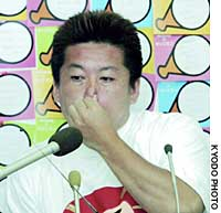 Takafumi Horie faces reporters Sunday night at his office in Onomichi, Hiroshima Prefecture, as his defeat to Shizuka Kamei became imminent in the hotly contested Hiroshima No. 6 district