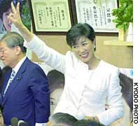 Environment Minister Yuriko Koike celebrates her victory in the Tokyo No. 10 district in front of her supporters Sunday.