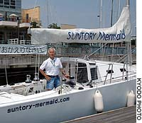 Adventurer Kenichi Horie stands on the deck of his 13-meter sloop Suntory Mermaid at Shin Nishinomiya Yacht Harbor in Hyogo Prefecture after returning from an eight-month solo circumnavigation.