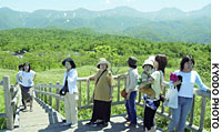 Tourists check out the view from an observation deck in July at a sightseeing spot featuring five lakes on the Shiretoko Peninsula.