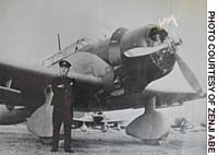 Zenji Abe poses in front of a bomber in Iwakuni, Yamaguchi Prefecture, in late December 1941, after returning from the Pearl Harbor attack.