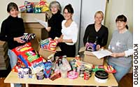 Sarah Daykin (center) and her team of helpers pack products in London recently that were then sent out to British expatriates.