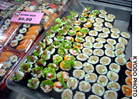 Various types of sushi rolls are shown on sale at a stall in Sydney.