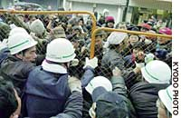 Osaka city officials force out homeless and their supporters Monday from Utsubo Park in Nishi Ward.
