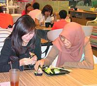 Nurdini Yatim (right) and her cousin try halal 'maki' rolls at a Ramen Ten restaurant in Singapore last year.