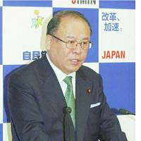 Liberal Democratic Party Secretary General Tsutomu Takebe faces reporters Friday at LDP headquarters in Tokyo.