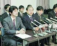 Lawyers representing a group of Livedoor Co. shareholders announce in a Tuesday news conference in Tokyo that they will file a damages lawsuit against former executives of the firm.