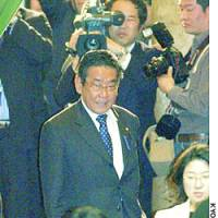 Indicted Lawmaker Shingo Nishimura walks into a Lower House plenary session Friday.