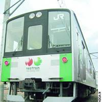 A prototype hybrid train sits on the tracks in Utsunomiya, Tochigi Prefecture, in December.